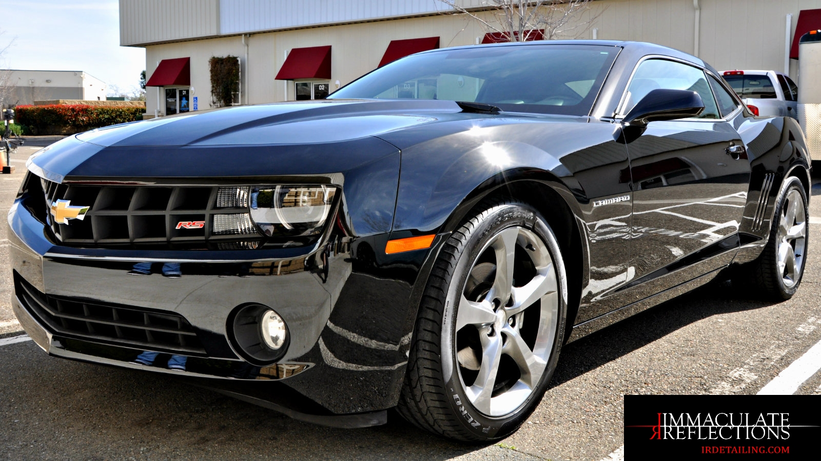 This Camaro sparkles like a polished onyx after Paint Correction & Pro Ceramic Nano Coating Detail Services by Immaculate Reflections.